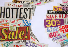 Hottest sale and coupon offers. It is HOTTEST Sale sign and a few of copon offers on white Stock Photos