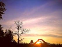 Houd hand en houd hart BC hand kan uw hitte steunen anytiime Stock Foto's