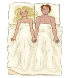 Houdend van paar die in bed liggen Stock Afbeelding