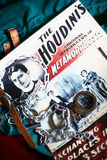 Houdini coloured poster handcuffs  chain strait jacket. Houdini poster coloured for Metamorphosis with handcuffs and chain on top and resting on a strait jacket Stock Images