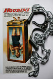 Houdini torture cell poster with handcuffs and chains. High security handcuffs as used by the police in UK with chain and Harry Houdini poster Stock Images