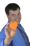 Houdt in een hand een symbool van hart Royalty-vrije Stock Foto's