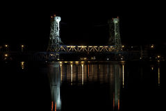 Houghton Lift Bridge. The Houghton Michigan lift bridge at night connecting the cities of Houghton and Hancock Michigan. The only entry point to the Keweenaw stock image