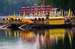 Houhai Lake Tourboats Beijing, China. Houhai Lake Tourboats Reflections Beijing, China. Houhai Lake is the old swimming hole in Beijing and is now surrounded by stock photo