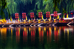 Houhai Lake Tourboats Beijing, China. Houhai Lake Tourboats Reflections Beijing, China. Houhai Lake is the old swimming hole in Beijing and is now surrounded by royalty free stock photos