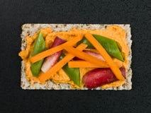 Houmous on Crispbread With Vegetables Stock Photo