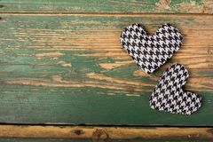 Houndstooth hearts on a green background Stock Image