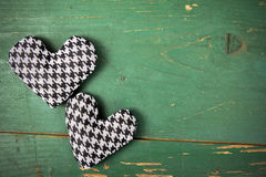 Houndstooth hearts on a green background Stock Images