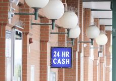 24 hour cash available sign above ATM machine at shop mall royalty free stock photography