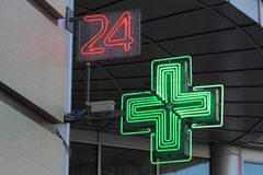 24-hour drugstore. Neon shining signboard of a drugstore meaning that it works 24 hours a day royalty free stock image