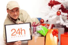 24 Hour Express Delivery, Even On Christmas. This delivery boy will work on x-mas, just to bring you your gifts in time Stock Photos