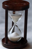 Hour glass. A hour glass, symbol for the time elapsing Royalty Free Stock Photos