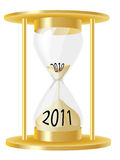 Hour glass 2011. A vector illustration of a hour glass depicting sand running out from 2010 and into 2011 Stock Image