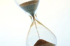 Hour glass. Hourglass counting the time time is running out Stock Photography