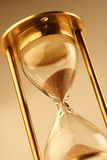 Hour glass. Hourglass counting the time is running out Royalty Free Stock Image