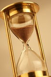 Hour glass. Hourglass counting the time is running out Royalty Free Stock Photography