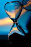 Hour Glass. Against a blue background royalty free stock photos