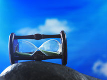 Hour glass against blue sky Royalty Free Stock Photos