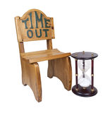 Hour Glass Next to Time Out Chair Royalty Free Stock Photos