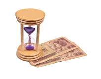 Hour Glass with old money Stock Image