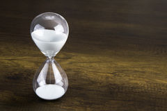 Hour glass presenting time concept Stock Photo
