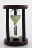 Hour Glass on White. Retro hourglass against on white background Royalty Free Stock Photo