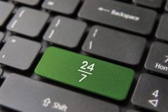 24/7 hour always open internet business keyboard. Always open concept for 24 hour internet business, computer keyboard button with 24/7 icon on keypad in green Stock Images