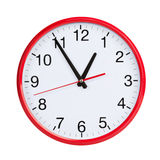 Almost an hour on a round clock face Royalty Free Stock Images