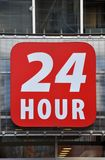 24 hour sign. Posted in front of the building Stock Photography