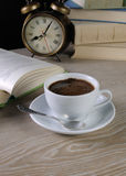 Hour to drink a cup of coffee at a table in the library Stock Photography