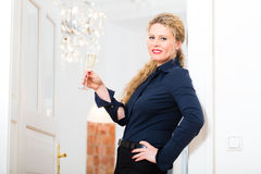 After Hour - woman at home with sparkling wine Stock Image