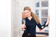 After Hour - woman at home with sparkling wine Stock Photo