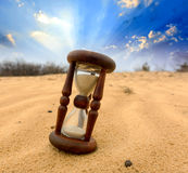 Hourgass in desert on sand Royalty Free Stock Photography