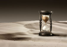 Hourglass. View of hourglass in a desert Royalty Free Stock Photography