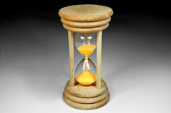 Hourglass. Yellow sand droping hourglass isolated Royalty Free Stock Image