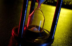 Hourglass. Photo of an Hourglass With Gel Lighting Royalty Free Stock Images