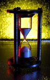 Hourglass. Photo of an Hourglass With Gel Lighting Royalty Free Stock Photo