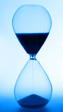 Hourglass. Backlit hourglass with blue tone Royalty Free Stock Photos