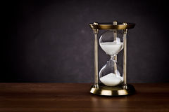 Hourglass. On a black background Royalty Free Stock Photo