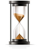 Hourglass. Sand flowing through an hourglass front view Stock Photos
