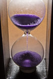 Hourglass. Good hourglass with purple sand Stock Image