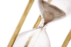 Hourglass. Close up of hourglass isolated on white background, selective focus Royalty Free Stock Photography