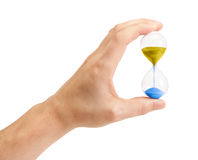 Hourglass. Hand holding an hourglass isolated on white background Stock Photography