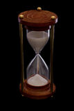 Hourglass. On a dark setting, concept of time passing Royalty Free Stock Images