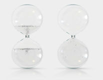 Hourglass. Two hourglass with white background Royalty Free Stock Image