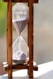 Hourglass. A hourglass isolated on nature background Royalty Free Stock Images