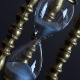 Hourglass. Bronze hourglass against a black background Royalty Free Stock Image