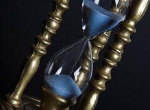 Hourglass. Bronze hourglass against a black background Royalty Free Stock Photos