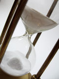Hourglass. Close up view of vintage brass hourglass Royalty Free Stock Photo