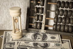 Hourglass with abacus and banknote Stock Photo